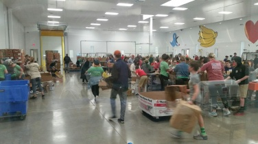 Speedway campus students in the warehouse